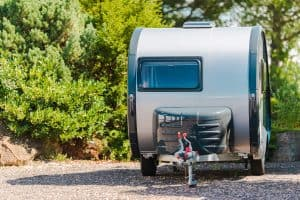 Vacation in the Travel Trailer. Compact Trailer in the RV Park.